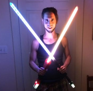 Mike with light-ups swords he designed, 3D printed, wired, and coded